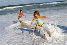 Outer Banks attractions | Kids playing on Beach in Outer Banks